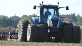 New Holland TG230 Working Hard in The Field Cultivating w Dal-Bo AXR H 600 Cultivator DK Agri