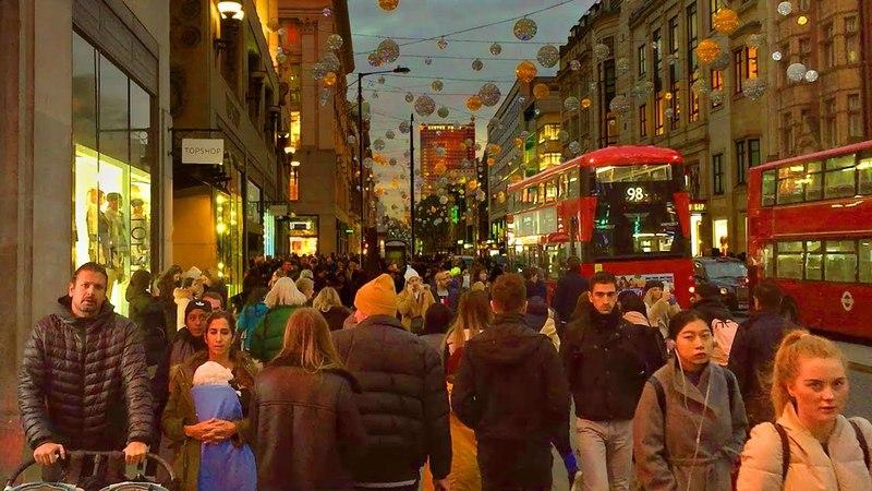 London Walk Oxford Street at Christmas Tottenham Court Road to Oxford Circus England UK