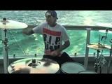 Travis Barker drumming in the middle of the Atlantic Ocean