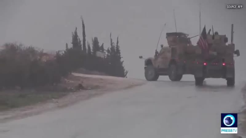 U.S. military vehicles patrol in the Syrian city of Manbij, despite Trumps shocking announcement t