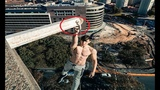 Heart stopping moment daredevil YouTuber dangles from 300ft skyscraper by one hand