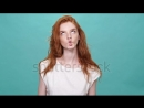 stock-footage-happy-funny-ginger-woman-in-t-shirt-showing-grimaces-at-camera-over-turquoise-background