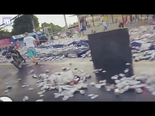 Locals go into looting frenzy after 80,00 cans of beer spilt
