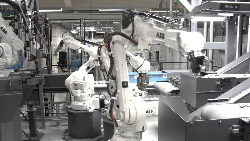 Assembly cell at Husqvarna 2 SVIA MiniFlex and 6 ABB robots