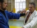 Воздействием на кисть боремся с захватом за отворот, с Антоном Мамаевым.