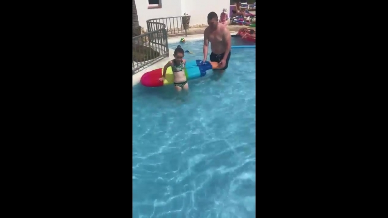 Lad pushes inflatable away from young girl trying to jump onto it