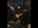 Rich Brian arm wrestling with dad