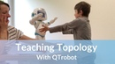 Robot helping children with Autism - QTrobot teaching topology
