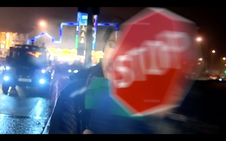 Reporter hit by stop sign during live tv.