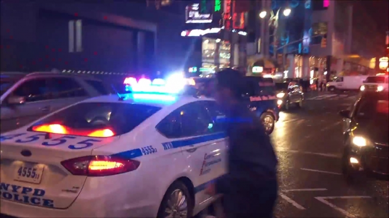 NYPD Police Car Responding Against Traffic With Lots Of Rumbler Siren In Midtown Manhattan