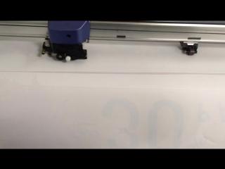 Печать наклеек на прозрачной плёнке в зеркале с ламинацией и резкой по контуру. Поклейка с внутренней стороны стекла витрины.