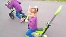 Ника катается на велике в парке Кто быстрее Беговел против велосипеда