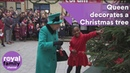 The Queen decorates a Christmas tree at a new national childrens centre