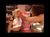 Raw 09.06.2004 - Trish Stratus decided to annoy Nidia, who yells at her in spanish and throws a beverage on her!