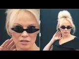 Pamela Anderson rolling around in chair in Georgian designer's cat sunglasses ( 28 march 2018)