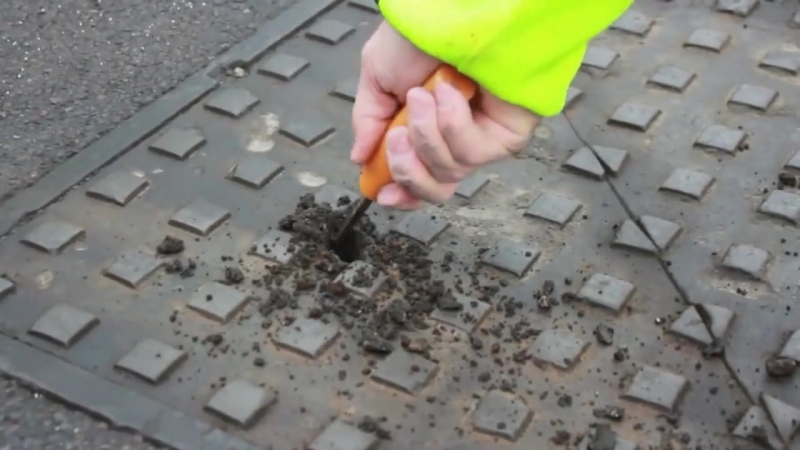Securing man hole cover │ Application of skid resistant marking