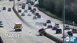 VIDEO | Out-of-control truck takes out light poles on Milwaukee freeway, driver arrested