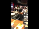 Lad catches bowls at Teppanyaki restaurant then falls off his chair