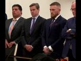 Конор МакГрегор и люди в чёрном выходят из здания суда ;)