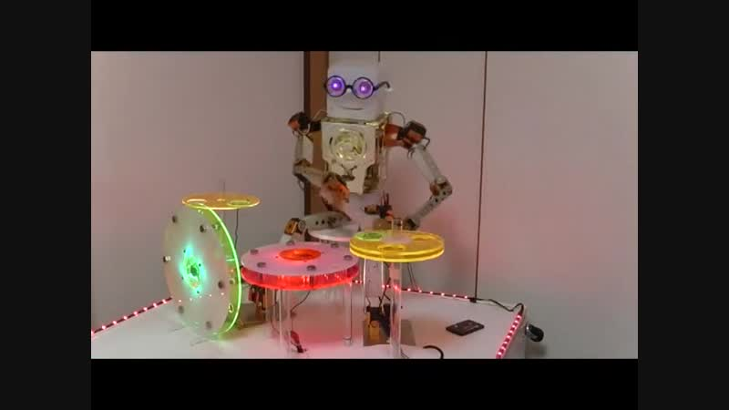 Robot percussionist plays electric drums and steelpan like instrument