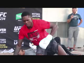 Israel adesanya hits the stunner, the rock bottom and the peoples elbow at ufc 234 open workouts