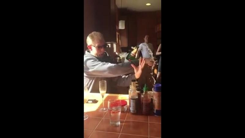 Guy Opening Champagne Drops Bottle on Floor - 986532