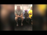 Kind subway rider lets a kid play video games on his phone