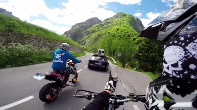 Motard versus Audi RS6 on small road