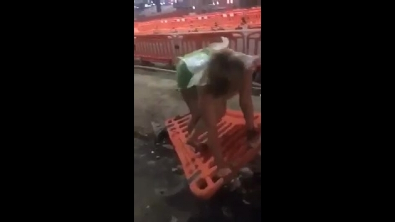 Drunk girl dressed as Tinkerbell tries to climb a fence and bangs her head on th