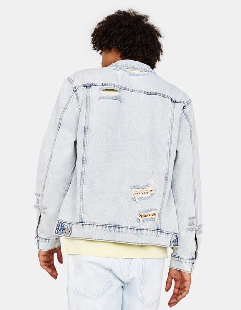 Джинсовая куртка объемного кроя с принтом
