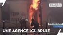 Gilets jaunes: une agence LCL brûle devant nous