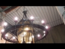 Кованая люстра-колесо с фонарем.