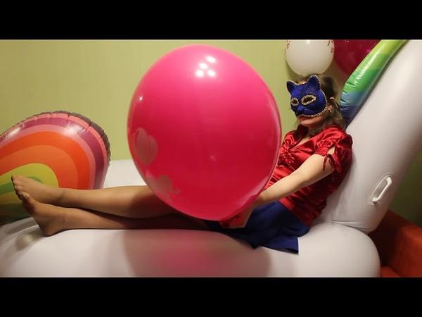 Blowing pink Tuftex 17 Unicorn balloon ON an inflatable unicorn (no pop)
