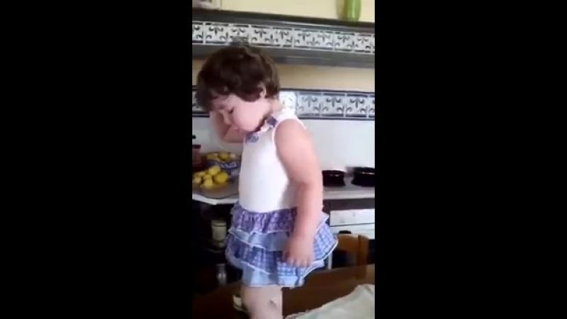 Young girl poses when she sees the camera on her
