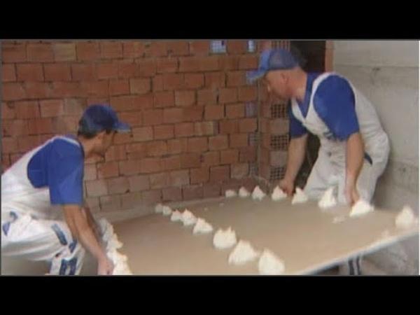 Bakın almanların tekniğine alçıpanı duvara nasıl döşüyor.