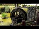Декорация в парке. Колесо водяной мельницы со смещением центром масс.