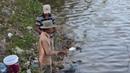Fishing on a plastic bottle in Vietnam Phan Thiet on the river Phu Hai
