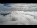 Черный гомар за облаками