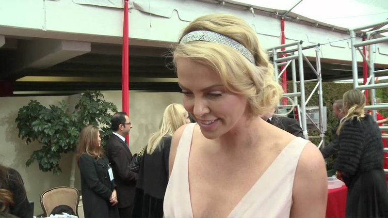 Charlize Theron - HFPA Red Carpet Interview- Golden Globes 2012