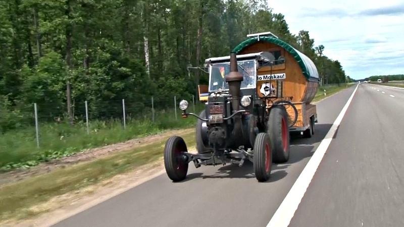 Немец едет на ЧМ-2018 на тракторе и с собакой