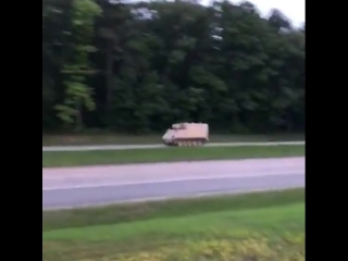 Police chase a tank