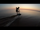Skimboard fun at sunset