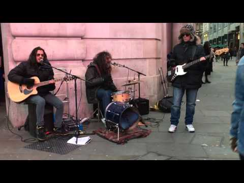 The Police Message in a Bottle busking in the streets of London UK