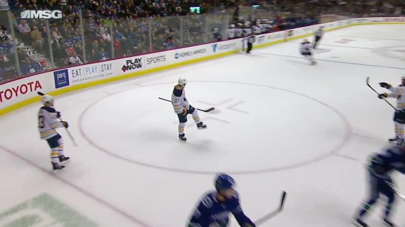 Sam Reinhart patiently waits to roof backhand over Demko