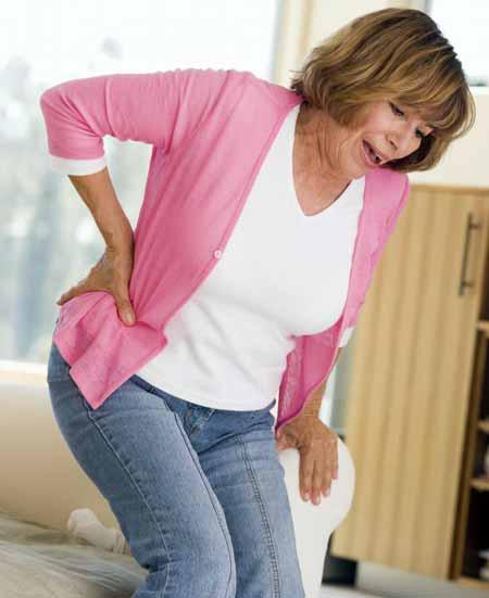 Рост яичников может вызвать боль в нижней части спины.