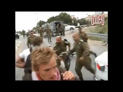 SHOCKING IMAGES! An 'Israeli' soldier hits a Danish protester with his rifle butt in the face!