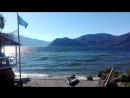 Флаг РГО над бухтой Заповедного Приюта