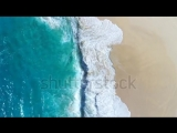 stock-footage-aerial-view-waves-break-on-white-sand-beach-at-sunset-sea-waves-on-the-beautiful-beach-aerial-view