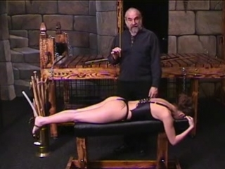 1476214_corseted_brunette_lies_down_on_bench_so_dude_can_cane_her_ass.mp4