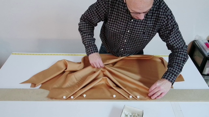 Close up view of professionally pleating a swag valance.